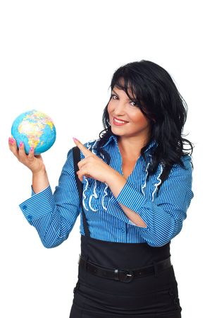 Beautiful business woman holding a globe  and pointing to object isolated on white background photo
