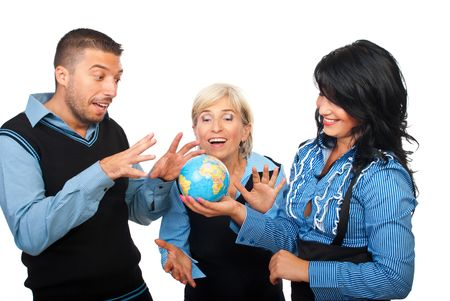 Three business people team having fun and laughing around a world globe isolated on white background photo