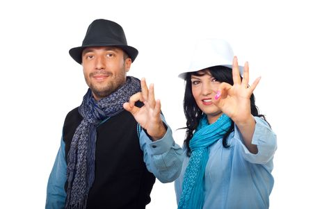Casual cool businesspeople couple wearing hats and scarves and  showing okay signhand isolated on white background photo