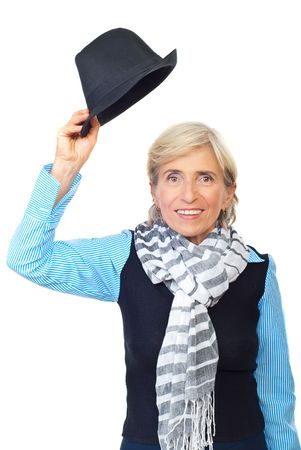 Senior woman raising hat  and expression her admiration for you:Hats off  to you! Isolated on white background photo