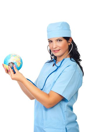 Attractive doctor woman standing in semi profile and examine a  world globe with her stethoscope isolated on white background Stock Photo - 7837155
