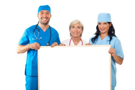 Happy group of doctors holding  balnk banner  isolatd on white background