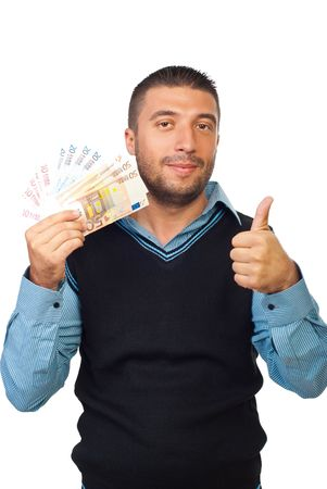 Smiling business man holding euro banknotes and giving thumb up isolated on white background photo