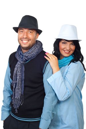 Fashionable young couple wearing black and white hats and scarves and smiling for you isolated on white background photo