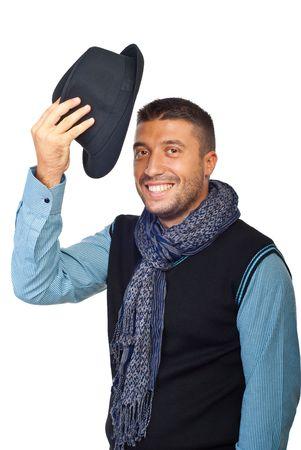 hands off: Hombre joven elevar su sombrero en respeto y admiraci�n para alguien aislados sobre fondo blanco  Foto de archivo
