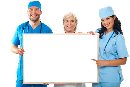 Happy group of doctors holding a lank placard and a doctor woman pointing to copy space banner isolated on white background photo