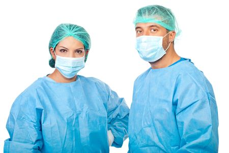 Two zoung surgeons in sterile uniforms ,caps and protective mask preparing for operation isolated on white background Stock Photo - 7837259