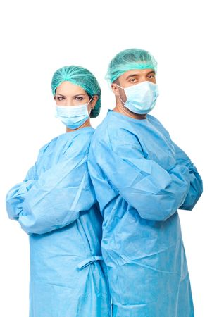 Two surgeons  in sterile uniforms standing back to back with arms folded and looking camera isolated on white background Stock Photo - 7837257