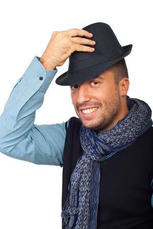 Portrait of handsome man holding hand on his black hat isolated on white background Stock Photo - 7837482