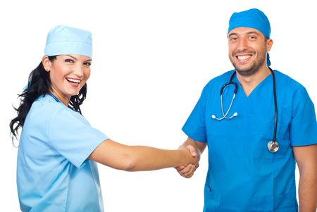 Two laughing doctors shaking their hands and congratulate each other isolated on white background Stock Photo - 7837267