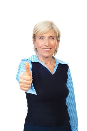 Happy senior business woman giving thumbs up isolated on white background photo