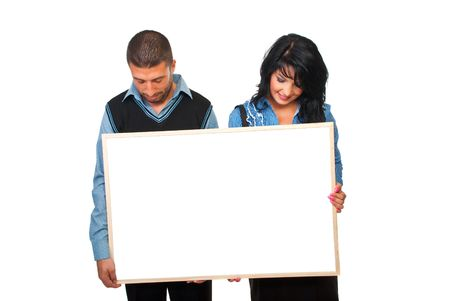 Two business people holding a cardboard and looking down to copy space isolated on white background photo