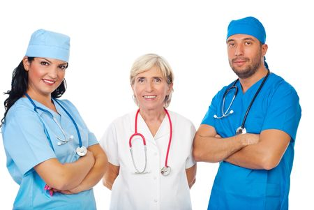 Happy staff of three diverse doctors standing with hands crossed isolated on white background photo