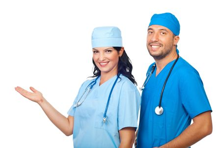 Two cheerful surgeons  with hand open in welcome sign or making a presentation to copy space isolated on white background Stock Photo - 7837493