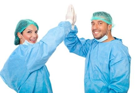 surgical glove: Happy surgeons team give high five and celebrate an successful surgery isolated on white background
