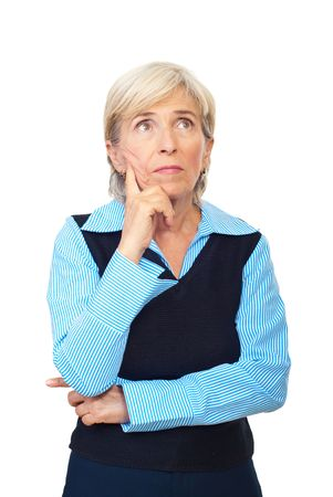 confused woman: Pensive senior business woman looking away and holding hand to face isolated on white background Stock Photo