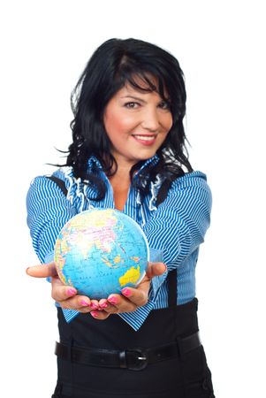 Happy woman holding a globe in her hands in front of camera   isolated on white background,selective focus on earth globe photo