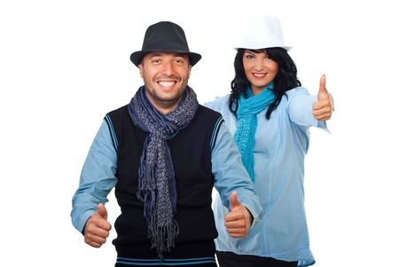 Cool happy couple giving thumbs up and smiling isolated on white background photo