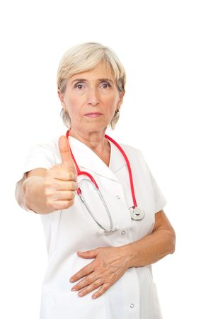 Senior doctor woman giving thumb up isolated on white background photo