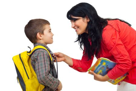 satchel: Mother having an conversation with her son before going to school and standing face to face isolated on white background Stock Photo