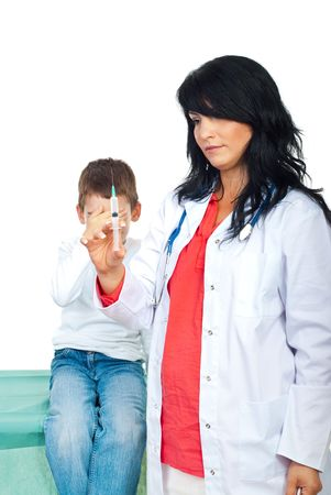 Doctor woman holding a syringe and the kid it is very scared and holding hand to his eyes isolated on white background Stock Photo - 7837562