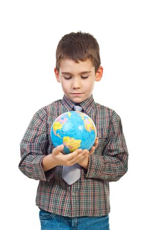 Preschool boy holding a world globe and looking to object isolated on white background