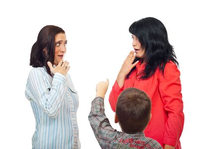 accuser: Little boy pointing to two women and they are surprised and scared isolated on white background Stock Photo
