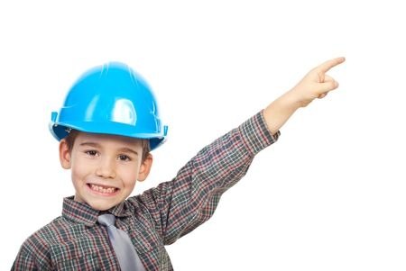 Small architect boy with helmet pointinng up to copy space and smiling with his missing teeth isolated on white background photo