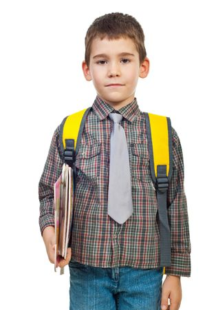 the first day: Little boy in first day on school holding bag and books isolated on white background