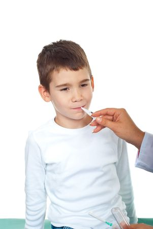Doctor checking temperature to a small boy isolated on white background photo