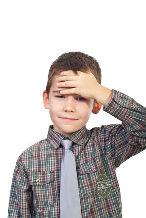 Boy with head ache or being confused holding hand to forehead isolated on white background photo