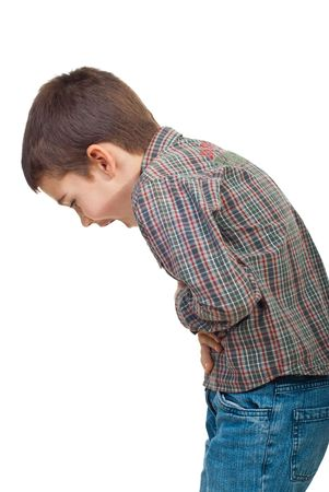 Child standing in profile  having a severe stomach ache and screaming isolated on white background photo