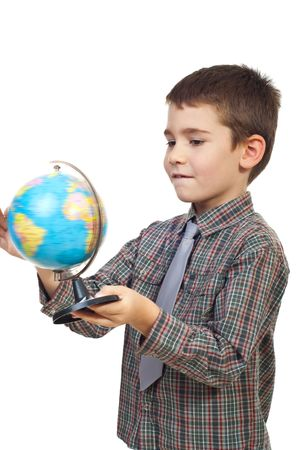 Child boy holding and rotate a terrestrial globe isolated on white background photo