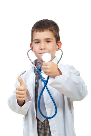 Successful future doctor boy showing stethoscope and giving thumbs upo isolated on white background photo