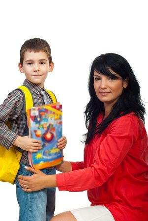 first day: Portrait of smiling mother with her son in first day of school holding books and bag isolate don white background Stock Photo
