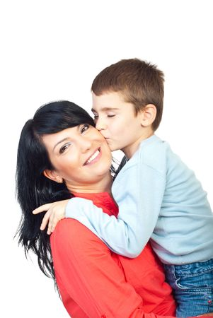 Sweet boy giving a warm kiss to his happy mother isolated on white background photo