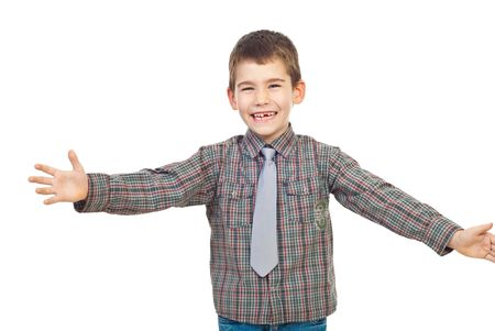Preschool child laughing and standing with arms open ready  for hug isolated on white background photo