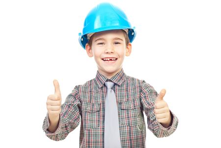 Laughing kid with blue hard hat giving thumbs up isolated on white background Stock Photo - 7907884