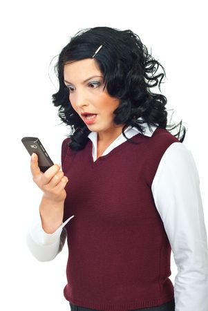 Woman holding a phone mobile and looks very shocked about  news or reading a strange text  message isolated on white background photo