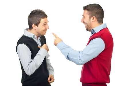Two men laughing and have fun while one of them accusing the other  and pointing to him isolated on white background photo