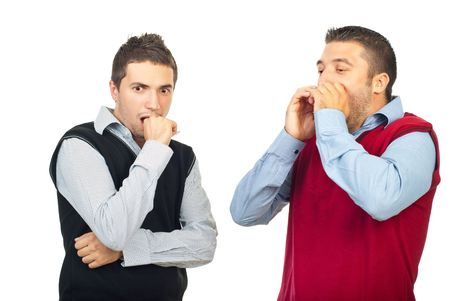 Two shocked men  looking away  and holding hands to mouth isolated on white background photo
