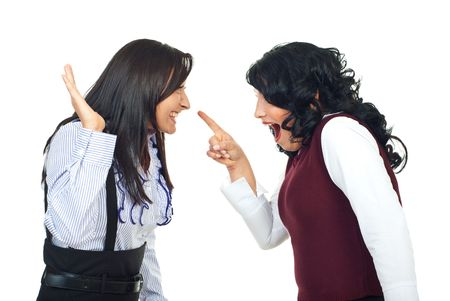 accuser: Two women haaving a funny confrontation and accusatory and laughing together isolated on white background Stock Photo