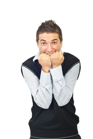 Desperate young man screaming and holding his hands to mouth isolated on white background Stock Photo - 7985424