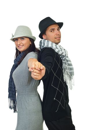 Modern fashionable couple standing back to back and holding hands isolated on white background Stock Photo - 7985473