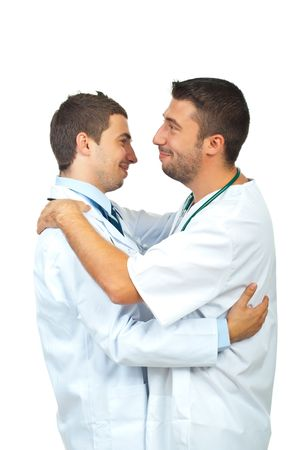 studio happy overall: Two happy doctors men  are congratulating and huggig  each other  isolated on white background Stock Photo