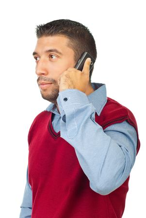 Mad adult man standing in semi profile and speaking by phone mobile isolated on white background photo