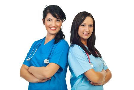 Team of two doctors women standing back to back with hands crossed isolated on white background photo