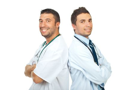 Two happy doctors men standing back to back with arms folded isolated on white background photo