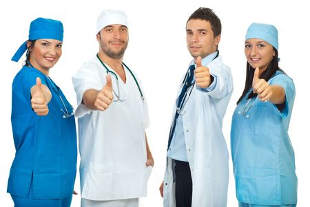 Successful group of four doctors giving thumbs up in a row isolated on white backgroud Stock Photo - 7985536