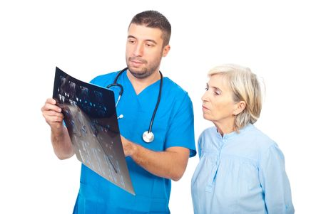 Doctor man showing and explaining his patient senior woman  the MRI scans results Stock Photo - 7985579